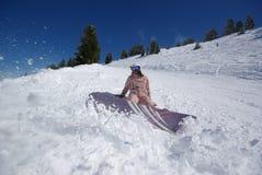 Salto bonito do snowboarder Imagem de Stock Royalty Free