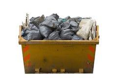 Salto con i sacchi rifiuti/dei rifiuti isolati Immagini Stock