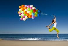 Salto con los globos Imagen de archivo libre de regalías
