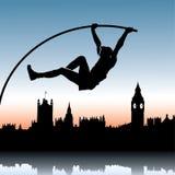Salto con pértiga sobre el horizonte de Londres Foto de archivo libre de regalías