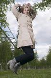 Salto da direita madura da mulher Foto de Stock