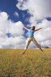 Salto da felicidade imagens de stock