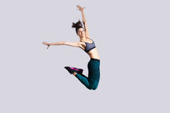 Salto da menina do adolescente Foto de Stock Royalty Free