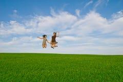 Salto da mulher e da criança Foto de Stock Royalty Free
