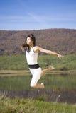 Salto da mulher nova Foto de Stock Royalty Free