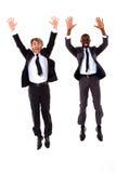 Salto de dois homens de negócios Fotos de Stock