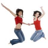 Salto de dos muchachas Imágenes de archivo libres de regalías