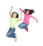 Salto de dos niños Fotografía de archivo libre de regalías