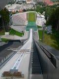 Salto de esqui competiam de quatro montes Fotografia de Stock Royalty Free