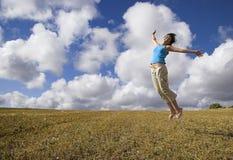 Salto de la felicidad Imagen de archivo libre de regalías