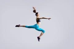 Salto de la muchacha del bailarín Imagen de archivo libre de regalías