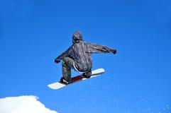 Salto de la muchacha del Snowboarder Imagen de archivo