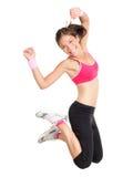 Salto de la mujer de la aptitud de la pérdida de peso Imagen de archivo libre de regalías