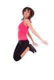 Salto de la mujer de la aptitud de la pérdida de peso de la alegría foto de archivo libre de regalías