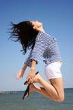 Salto de la mujer joven Fotografía de archivo libre de regalías