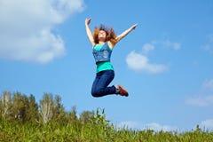 Salto de la mujer joven Imagen de archivo libre de regalías