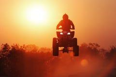 Salto de la silueta ATV Fotografía de archivo libre de regalías