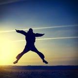 Salto de la silueta del hombre Foto de archivo libre de regalías