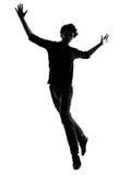 Salto de la silueta del hombre joven feliz Fotos de archivo libres de regalías