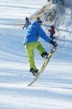 Salto de la snowboard Fotografía de archivo