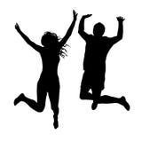 Salto de las siluetas de la mujer y del hombre Imagen de archivo libre de regalías