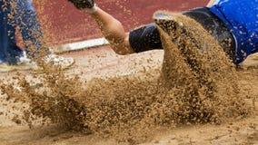 Salto de longitud en atletismo fotografía de archivo