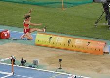 Salto de longitud, mujeres Foto de archivo libre de regalías