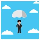 Salto de paraquedas do homem de negócios Imagem de Stock