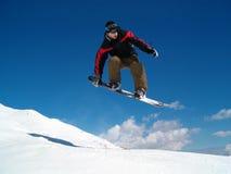 Salto de Snowborder Foto de archivo libre de regalías