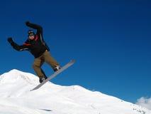 Salto de Snowborder Imagenes de archivo