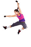 Salto del bailarín de la mujer joven Foto de archivo