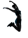 Salto del basculador del corredor de la mujer feliz foto de archivo libre de regalías