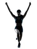 Salto del basculador del corredor de la mujer feliz Imagenes de archivo