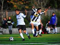 Salto del fútbol del club del Mens fotografía de archivo