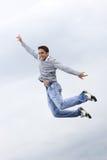 Salto del hombre feliz Imagenes de archivo