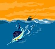 Salto del pez volador con el barco en b Fotos de archivo libres de regalías