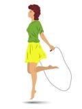 Salto della corda della ragazza della siluetta Fotografia Stock