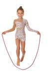Salto della corda di salto della ragazza Immagini Stock
