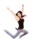 Salto della giovane donna Immagine Stock