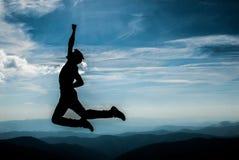 Salto della siluetta Fotografie Stock Libere da Diritti
