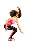 Salto desportivo da jovem mulher isolado no branco Fotografia de Stock Royalty Free
