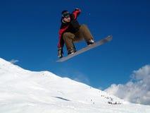 Salto di Snowborder Fotografia Stock
