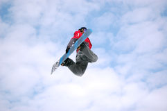Salto di torsione dello Snowboarder Immagini Stock