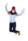 Salto divertido del adolescente aislado en blanco Foto de archivo libre de regalías