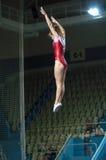 Salto em um trampolim Imagens de Stock