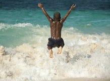 Salto en la playa Fotos de archivo