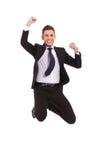 Salto extremamente excited do homem de negócio Imagens de Stock