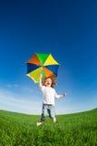 Salto felice del bambino Fotografie Stock
