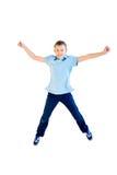 Salto felice del ragazzo Fotografia Stock