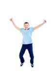Salto felice del ragazzo Fotografie Stock Libere da Diritti